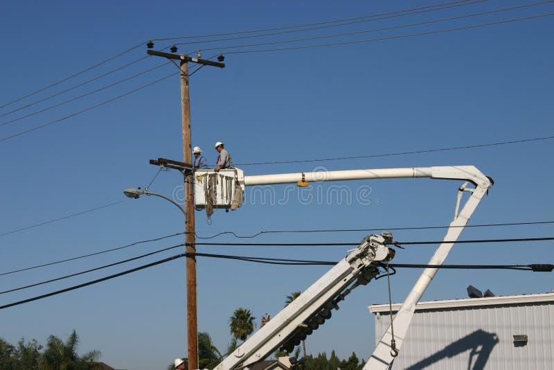Réparation 3 de ligne électrique photos libres de droits