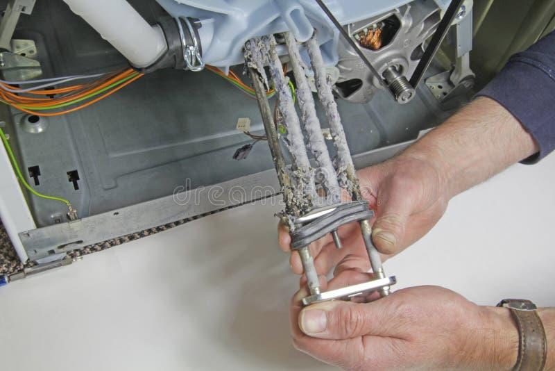 Réparation d'appareils de machine à laver photo libre de droits
