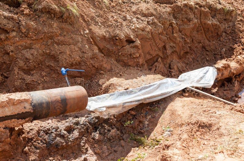 Réparation de la canalisation souterraine photo stock