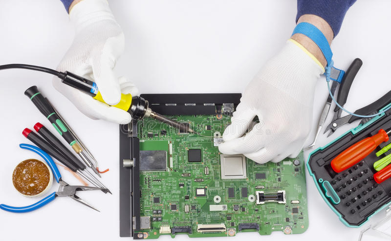 Réparation du concept numérique de carte électronique images stock