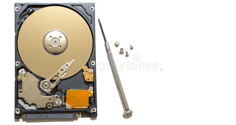Réparation du disque dur, des vis et des tournevis défectueux sur le banc image libre de droits