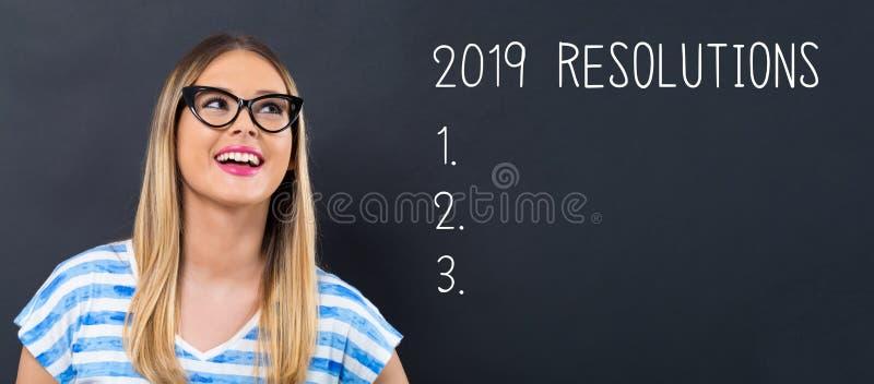 2019 résolutions avec la jeune femme heureuse photo stock