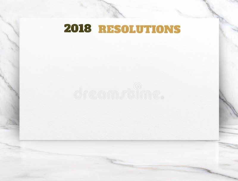 2018 résolutions de nouvelle année textotent sur l'affiche de livre blanc sur le mA blanc photographie stock