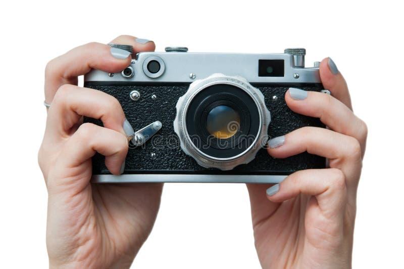 Rétro appareil-photo dans des mains image libre de droits