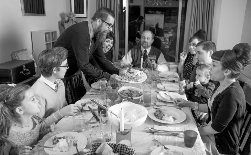 Rétro dîner Turquie de thanksgiving de famille de vintage photographie stock libre de droits