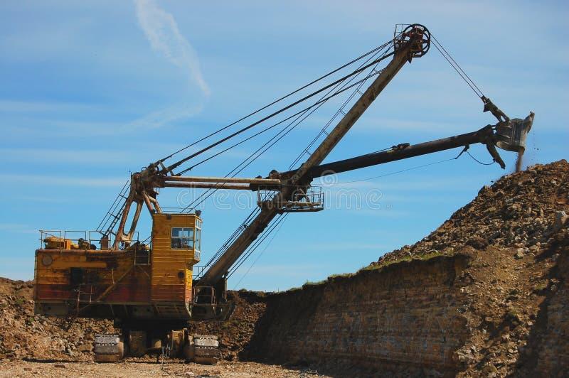Rétro excavatrice dans l'action images stock