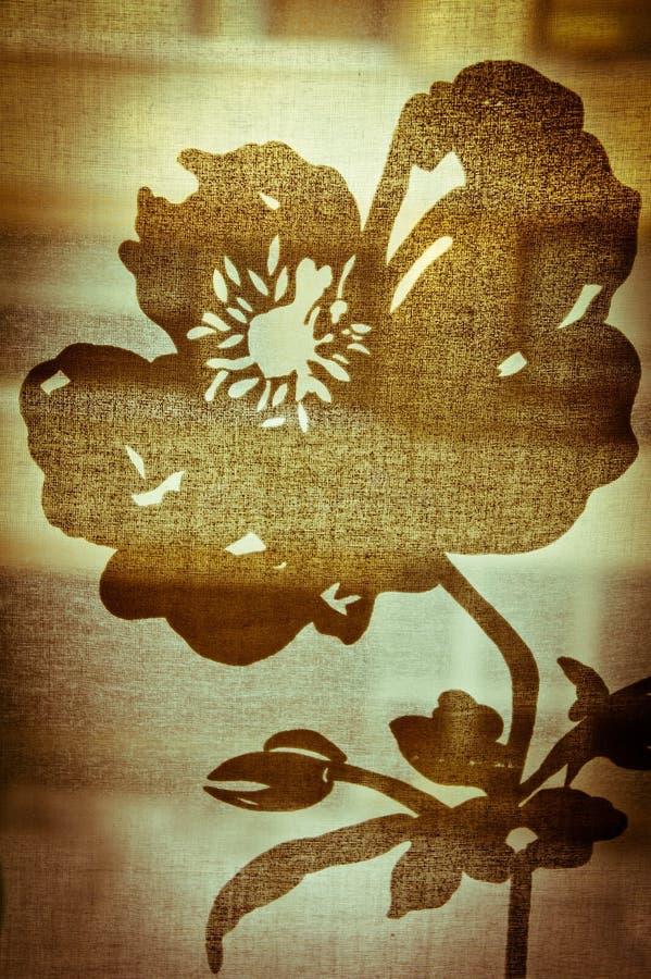 Rétro forme de fleur sur le textile   images stock