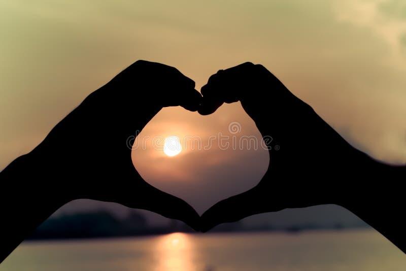 Download Rétro main de silhouette photo stock. Image du émotion - 56482152