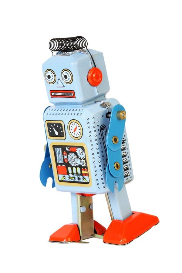 Rétro promenades mécaniques bleues de jouet de robot d'isolement images libres de droits