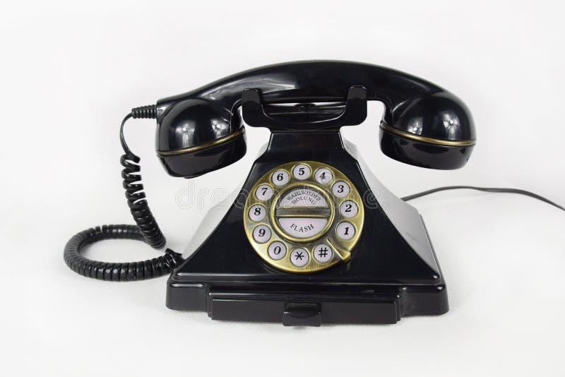 Rétro téléphone noir d'isolement photos stock