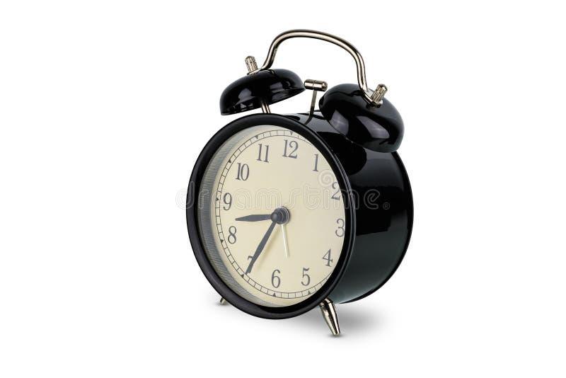 Réveil noir, cloche jumelle analogue d'isolement sur le blanc photos libres de droits