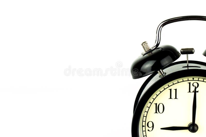 Réveil sur le blanc, montrant l'horloge de ` de neuf o image libre de droits