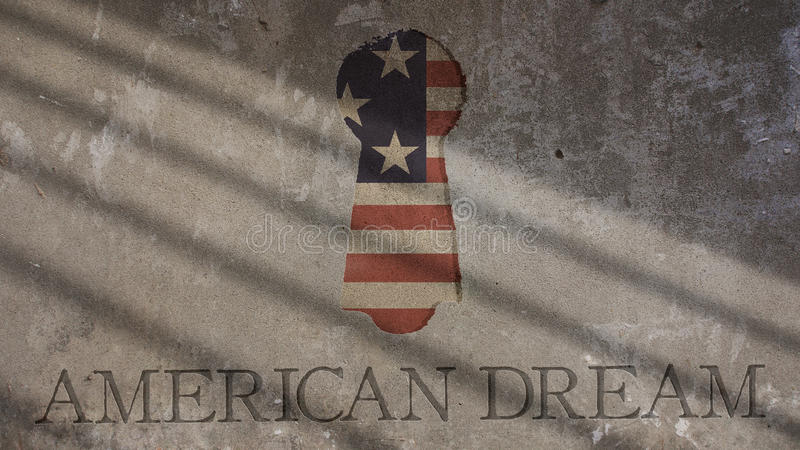 Rêve américain écrit sur un mur en béton Trou de la serrure photographie stock libre de droits