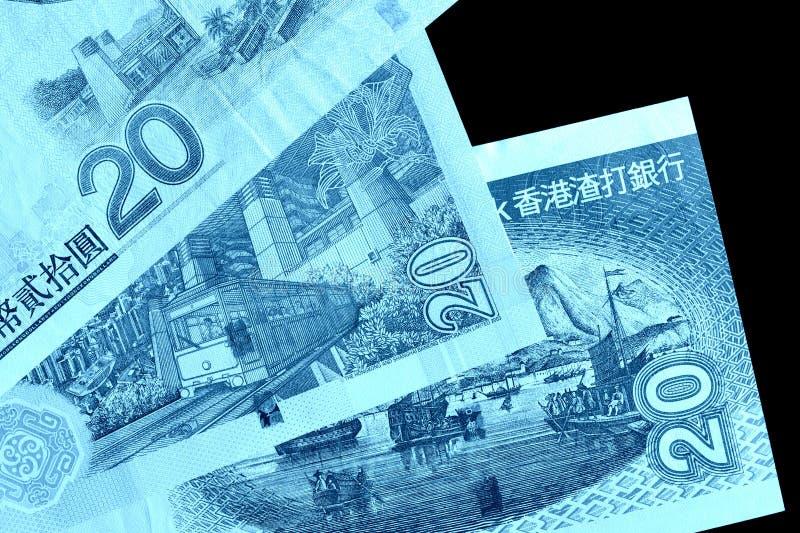 Różni rachunki w dwadzieścia Hong Kong dolarach Pieniądze tła błękitny kolor tonujący zdjęcie stock