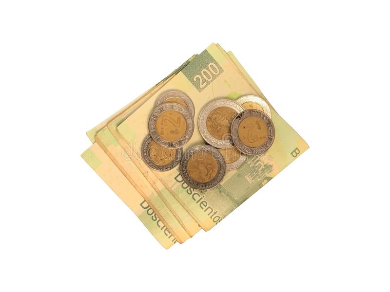 Różnorodne meksykanin monety na górze niektóre peso rachunków 100, 200, 500 i grupujący odosobniony na białym tle składający, zdjęcie stock