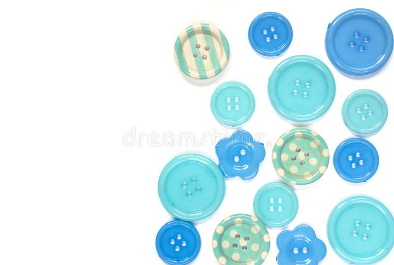 Różnorodni błękitni szy guziki odizolowywający na białym tle zdjęcia royalty free