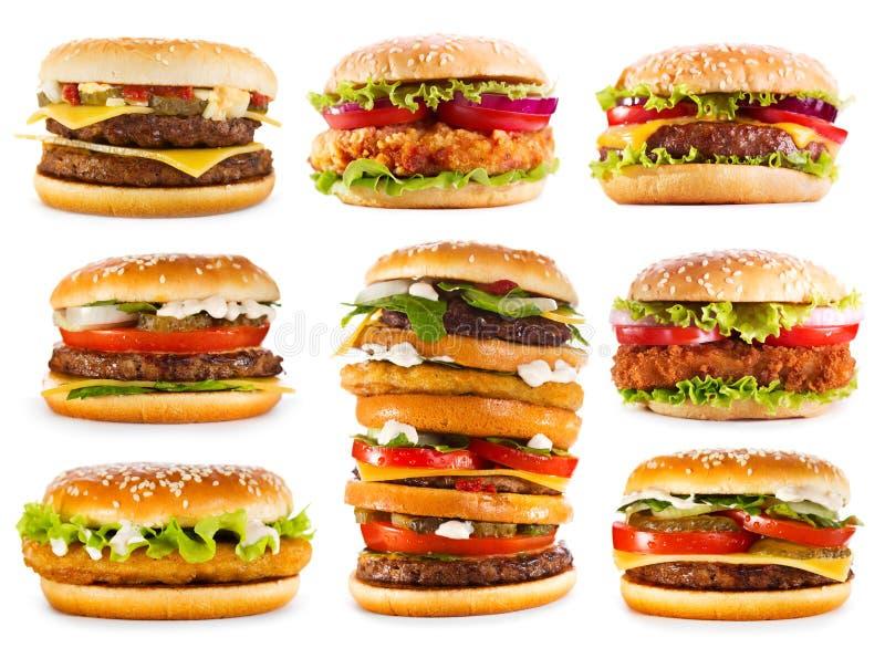 Różnorodni hamburgery odizolowywający na białym tle zdjęcia royalty free