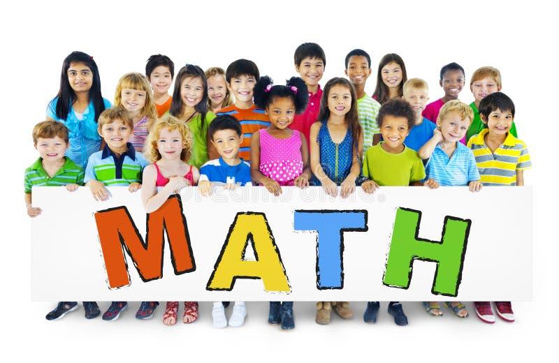 Różnorodni Rozochoceni dzieci Trzyma słowo matematykę zdjęcia stock