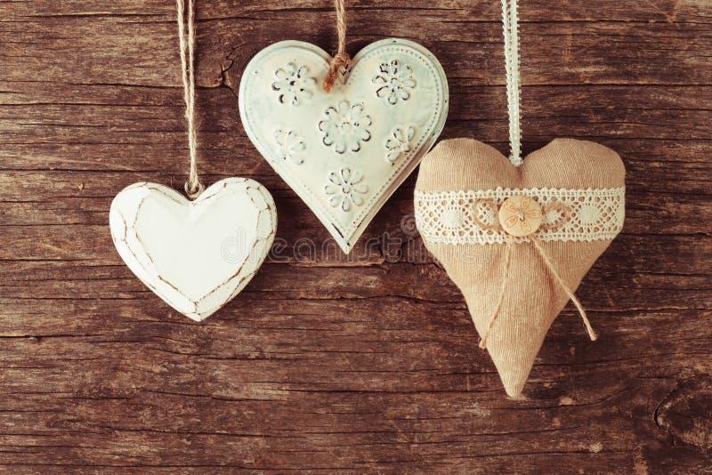 Różnorodny serce na drewnie obrazy stock