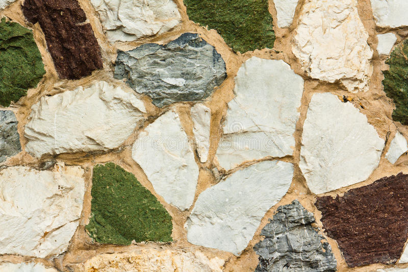 Różnorodnych kolorów kamienna ściana fotografia royalty free