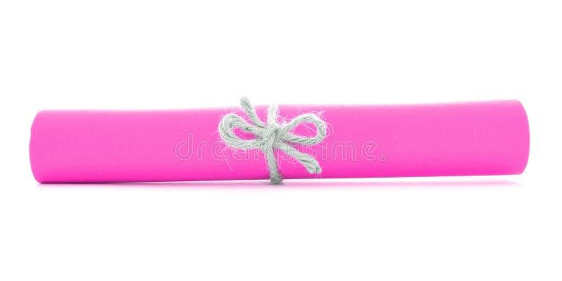 Różowa papierowa ślimacznica wiążąca z sznurkiem, pojedynczy naturalny guzek odizolowywający zdjęcie stock