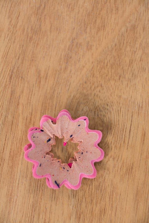 Różowego koloru ołówkowy golenie w kwiatu kształcie zdjęcia stock
