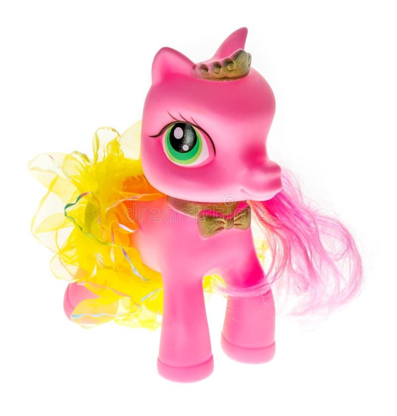 Różowy gumowy konik z dużymi oczami w spódnicie diadem - bawi się dla małych dziewczynek obrazy royalty free