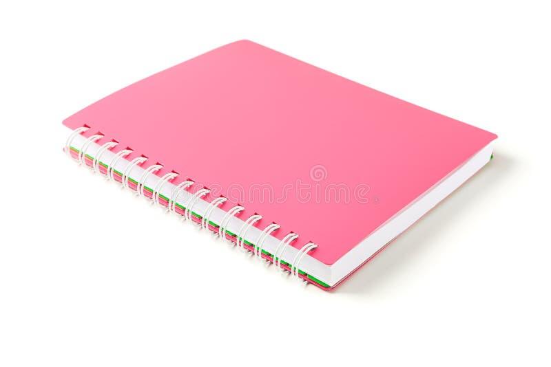 Różowy notatnik z przestrzenią dla teksta odizolowywającego zdjęcie stock