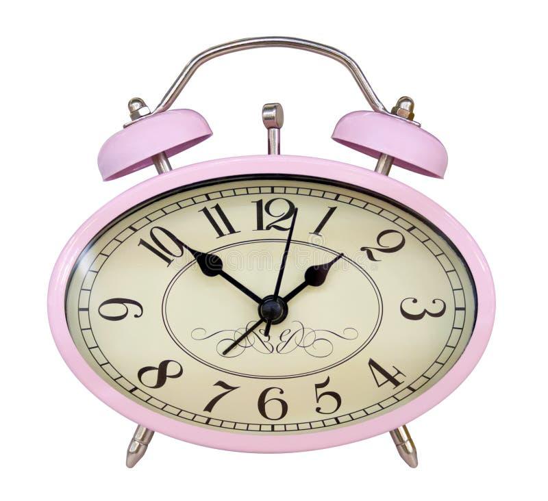 Różowy owalny budzik odizolowywający na bielu zdjęcie stock