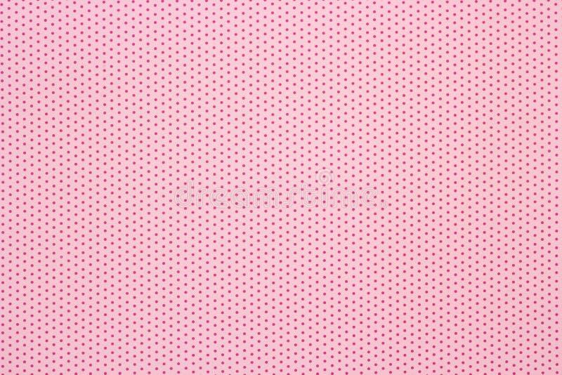 Różowy polek kropek wzoru tło, odgórny widok zdjęcie stock