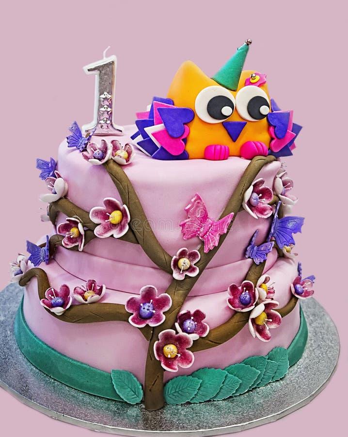 Różowy urodzinowy tort dla jeden roczniak dziewczyny fotografia stock