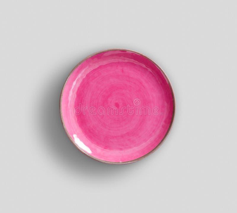 Różowy zawijasa Melamine talerz z światłem - szary tło obraz stock