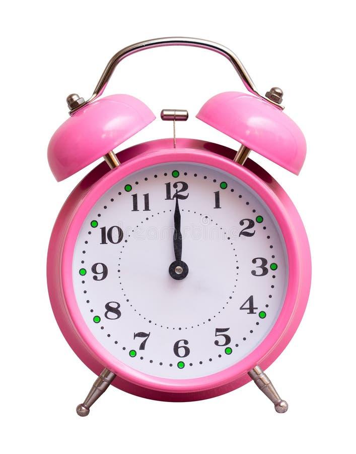 Różowy zegar na białym odosobnionym tle który pokazuje 12 godziny, Nowy rok przychodził zdjęcie stock