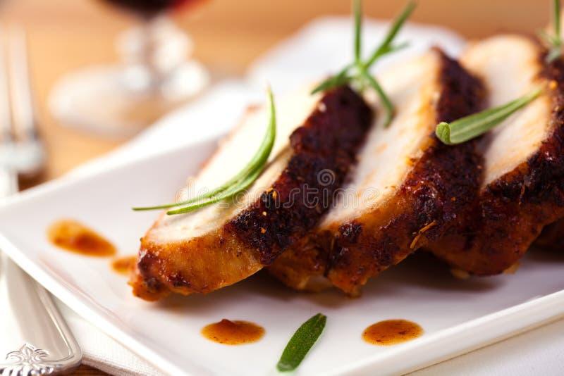 Rôti de porc avec le romarin frais photographie stock libre de droits