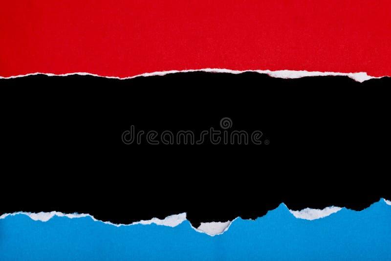 Röd andblue rivet papper arkivbilder