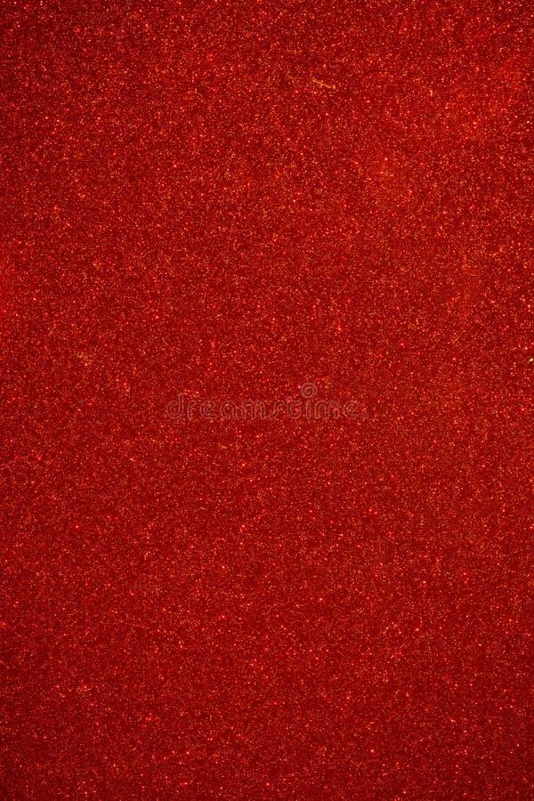 Röd bakgrund för skinande partiklar arkivbilder