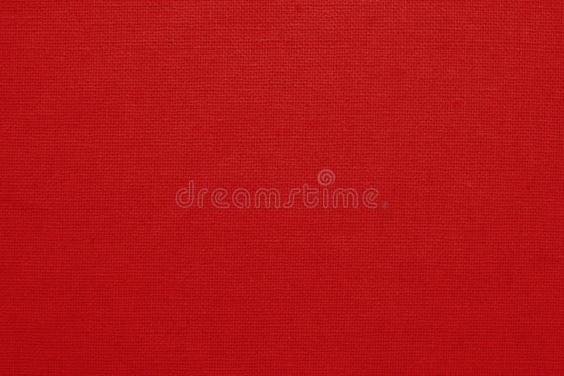 Röd bakgrund för textur för bomullstyg, sömlös modell av den naturliga textilen arkivfoton