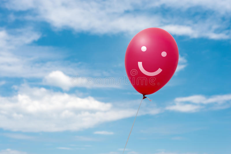 Röd ballong i himlen royaltyfri fotografi