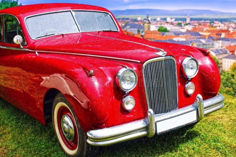 Röd bil Jaguar för tappning tätt upp royaltyfri bild