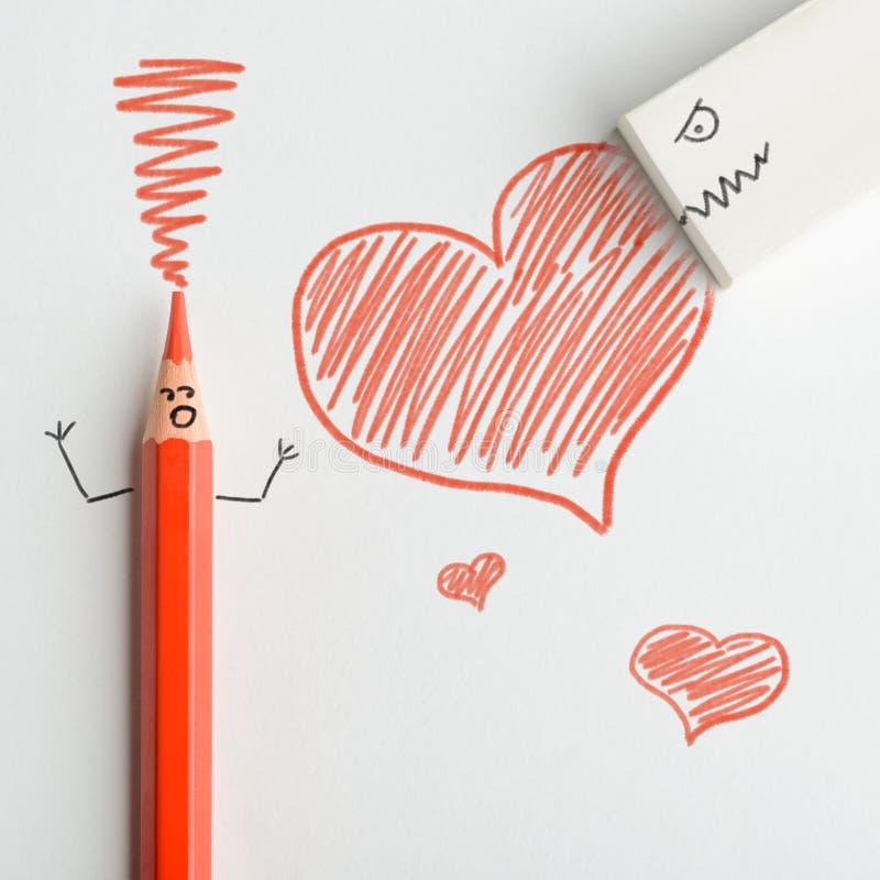 Röd blyertspenna och radergummi royaltyfria bilder