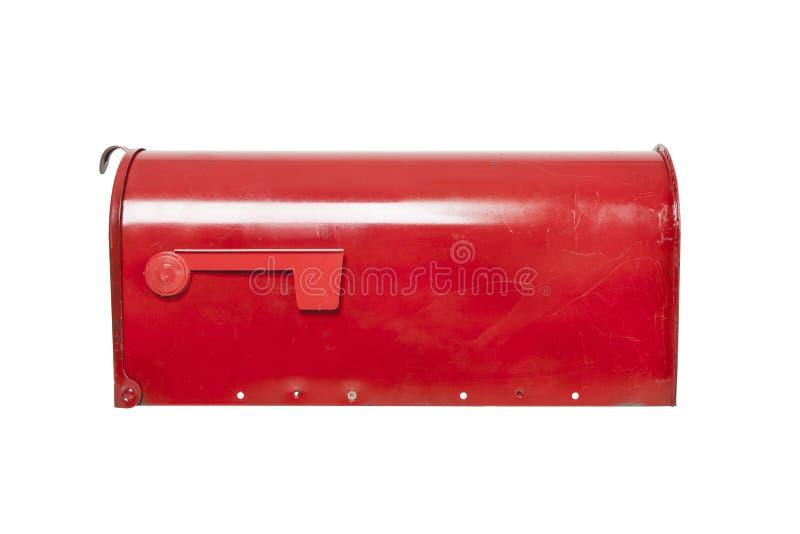 Röd brevlåda på vit med flaggan royaltyfri foto