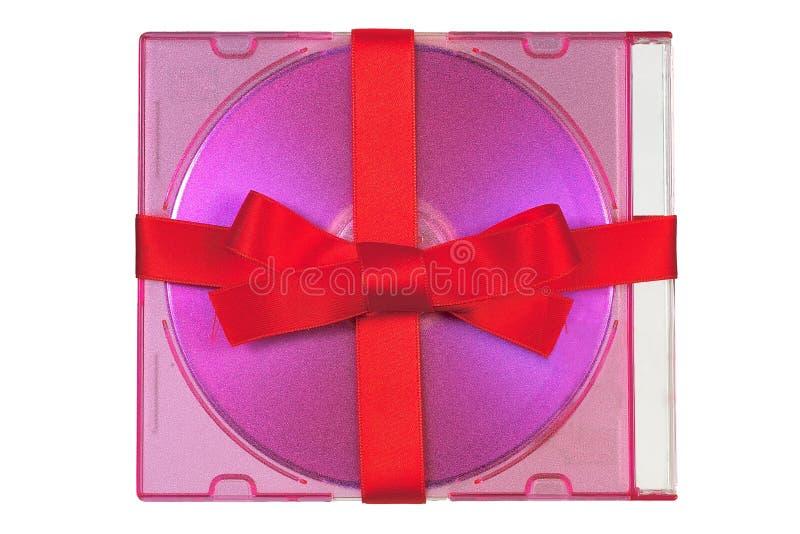 röd bunden bandsatäng för cd gåva royaltyfri bild