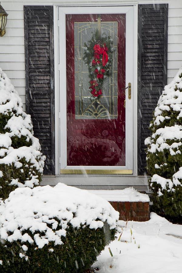Röd dörrsnöstorm royaltyfria foton