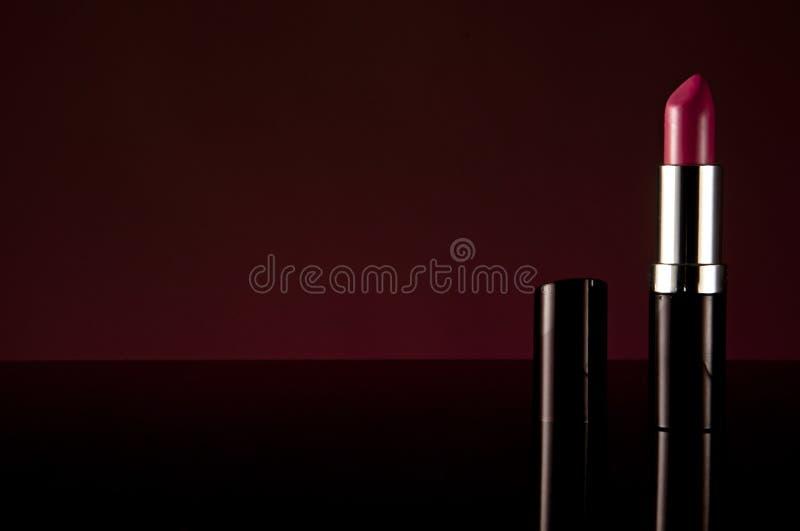 Röd eller rosa läppstift arkivfoton
