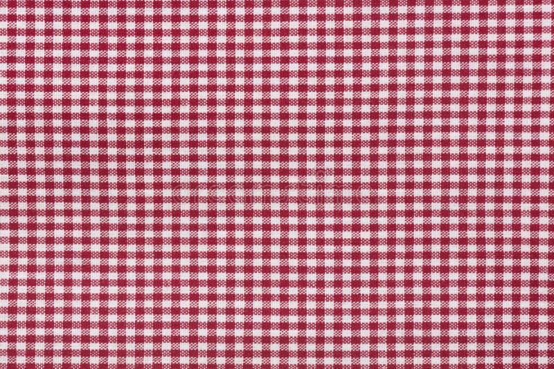 Röd för bordduk rutig och vit texturbakgrund, specificerad höjdpunkt royaltyfri fotografi