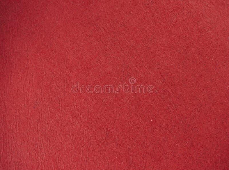 Röd filttexturbakgrund det isolerade vävde tyget royaltyfri fotografi