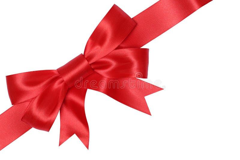 Röd gåvapilbåge för gåvor på jul, födelsedag eller valentindag royaltyfri bild