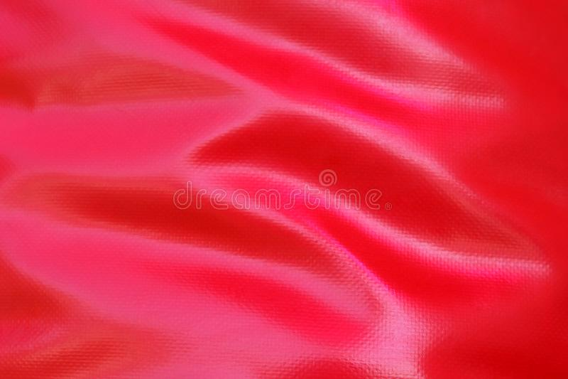 Röd gardintextur från grovt lädertyg royaltyfria bilder