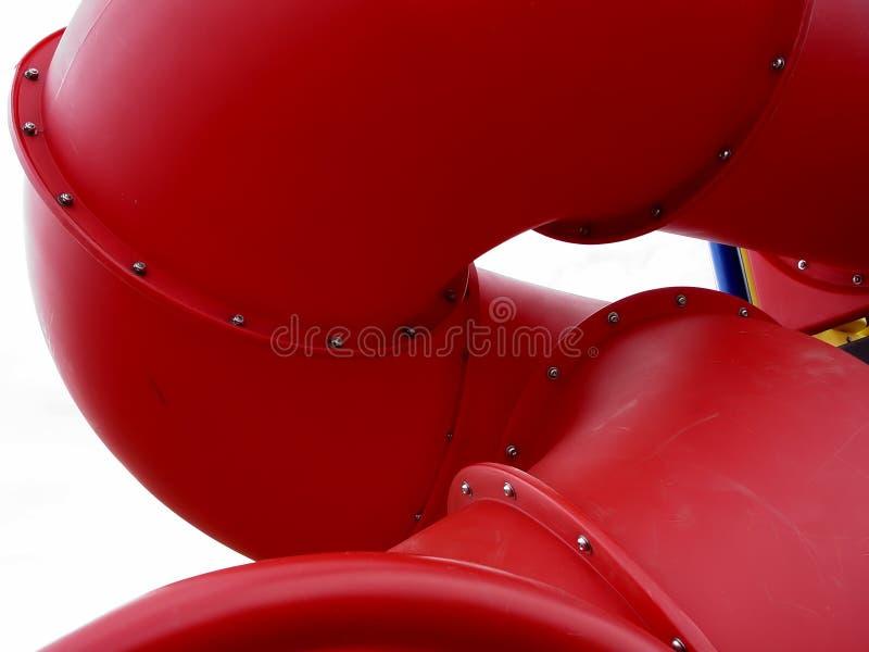 röd glidbana för lekplats arkivbild