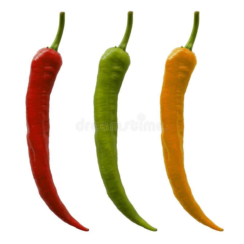 Röd, grön och gul peppar isolerad arkivfoton